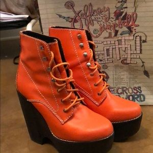 Used -Jeffrey Campbell Tardy boot in orange.